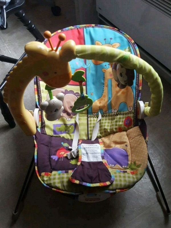baby's green and blue bouncer