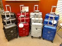 Four assorted color hard shell luggage Toronto, M3C 1V4