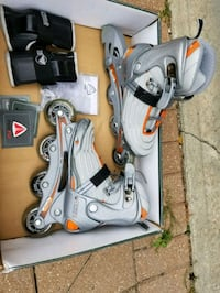 pair of white inline skates East Saint Paul, R2E 0G4