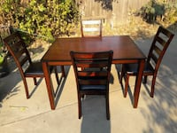 rectangular brown wooden table with four chairs di Suisun City