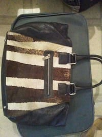 Leather and fur purse older but really well made Kelowna, V1X 4S8