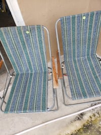 two brown wooden folding armchairs WASHINGTON