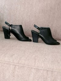 pair of black leather heeled booties North Vancouver, V7J