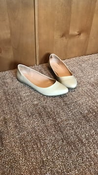 pair of white leather pointed-toe flats Edmonton, T6W 0R4
