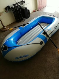 white and blue inflatable raft with rowing paddles Corona, 92882
