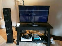 1080p TV with stand and tower speaker New Carrollton, 20784