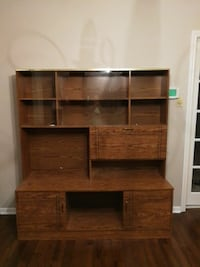 brown wooden entertainment system center