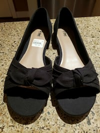 pair of black open-toe heeled sandals