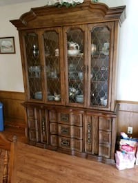 Table 6 chairs and China cabinet Tomball