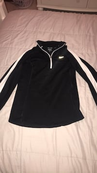 black and white Nike half-zip jacket