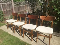 Four brown wooden framed white padded chairs Vancouver, V5N 4Z6