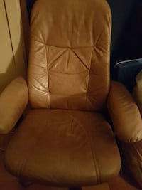 brown leather office rolling armchair
