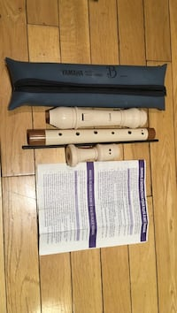 White and brown yamaha flute alto