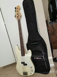 beige electric bass guitar with gig bag