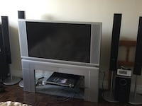 gray widescreen CRT television with TV stand Cambridge, N3H 1K9