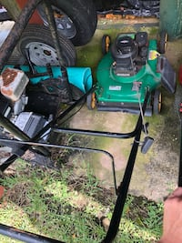 Green and black push mower 868 mi
