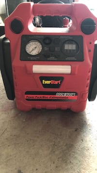 red and black Lincoln Electric welding machine