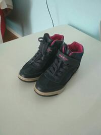 pair of black-and-red Geox mid-top sneakers