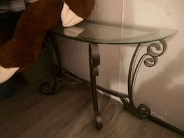 Beautiful glass rod iron entry table