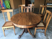 antique oak  pedestal table with six chairs dining set