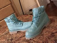 pair of blue suede boots 858 mi