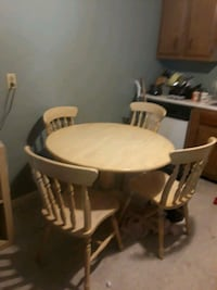 round brown wooden table with four chairs dining set Quincy, 02169