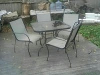 square glass top table with four-piece armchair patio set Brockton, 02301