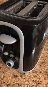 Black and gray keurig toaster  Thomasville, 27360