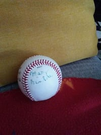 white and blue baseball with signature