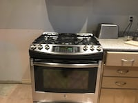 Stainless steel and black gas range oven Mississauga, L5R 3Y3