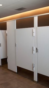 Powder coated metal bathroom stahls partitions and doors.