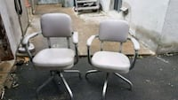 two gray leather salon chairs Laval, H7M 5Y3