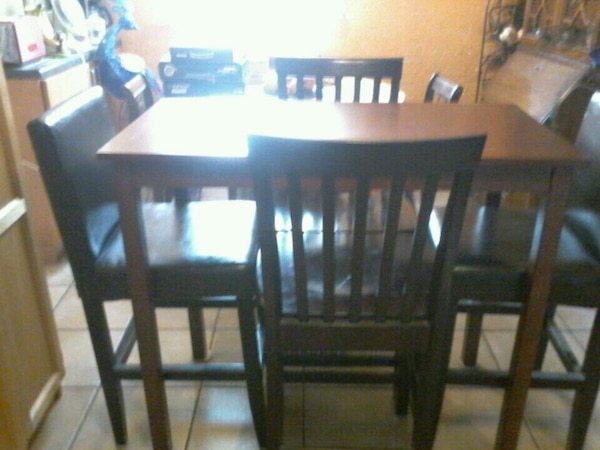Table  with 4 chairs and  3 extra  stools .
