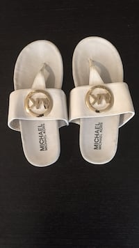 Pair of white michael kors leather sandals
