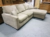 Beige Reversible Sectional Couch with Pillows