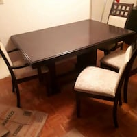 rectangular brown wooden table with four chairs dining set Port Hope, L1A 2M4