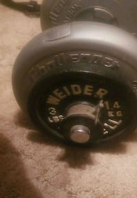 Adjustable barbell with weights 990 mi