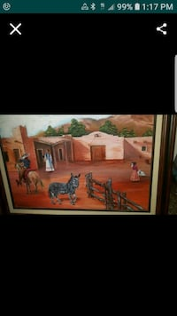 brown wooden framed painting of houses 42 km