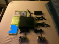black Xbox 360 slime with two controllers and four game cases Jamestown, 14701