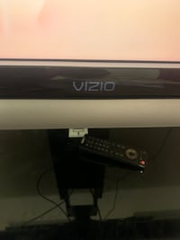 "42"" vizio Tv 1080p with original remote, and TV stand . Las Vegas, 89123"