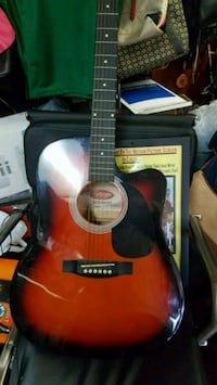 Stagg Red and black acoustic guitar