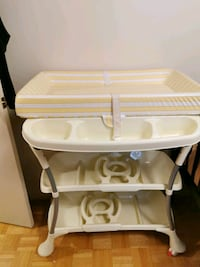 Baby bath with diaper changing table with storage.