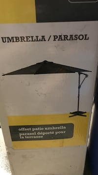 Black offset patio umbrella.  New in package.  Never used bought last summer.  Tampa, 33626