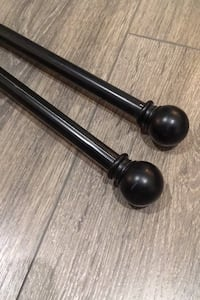 Two Black IKEA Curtain Rods with Clip Rings