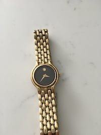 round gold analog watch with link bracelet Montréal, H1N 2Y5