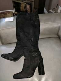 pair of black leather knee-high boots 1304 km