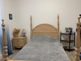 Full size bed and nightstand with mattress and lamp