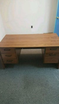 brown wooden single pedestal desk 44 km