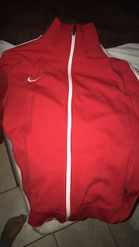 red and white Nike zip-up jacket