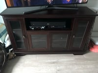 Wood and glass entertainment center. Like new condition  Orlando, 32839